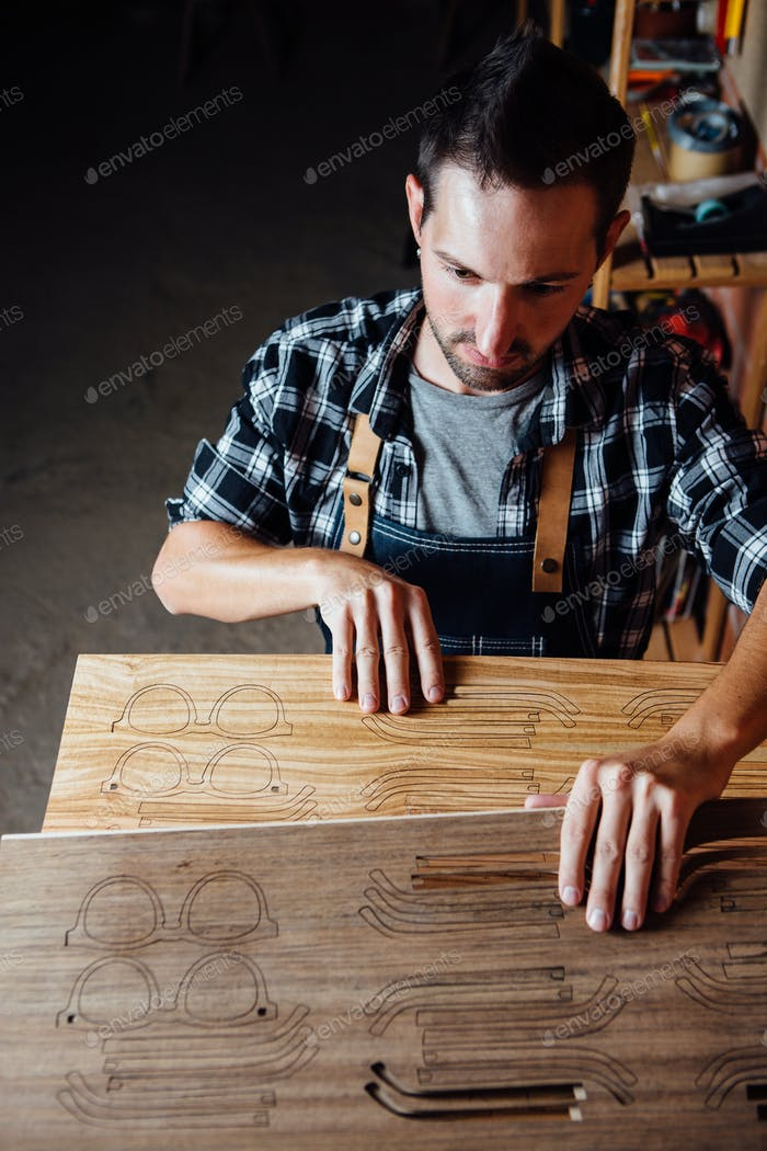 Man with wooden planks