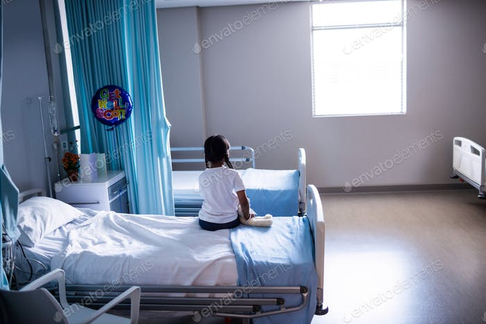 Patient sitting on bed