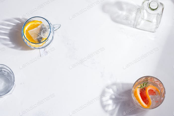Refreshing summer homemade cold tea drinks in the glass on a white background . Top view