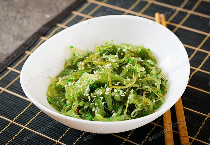 Wakame Chuka or seaweed salad  with sesame seeds in bowl