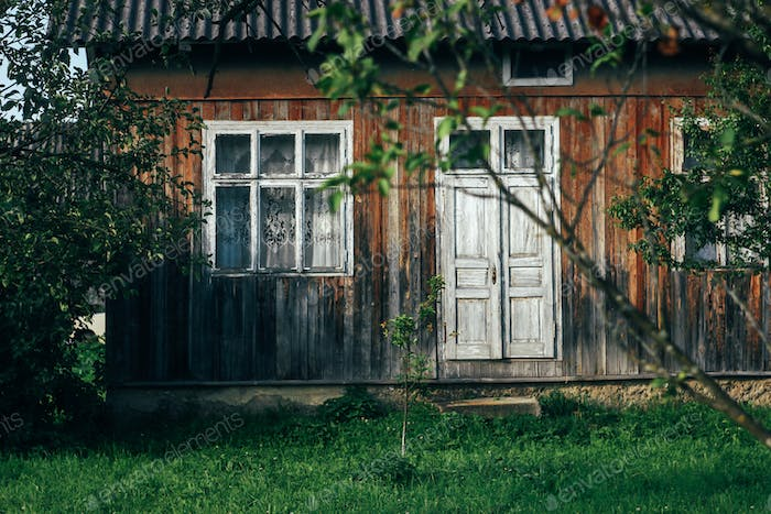 beautiful rustic wooden old building in sunny garden