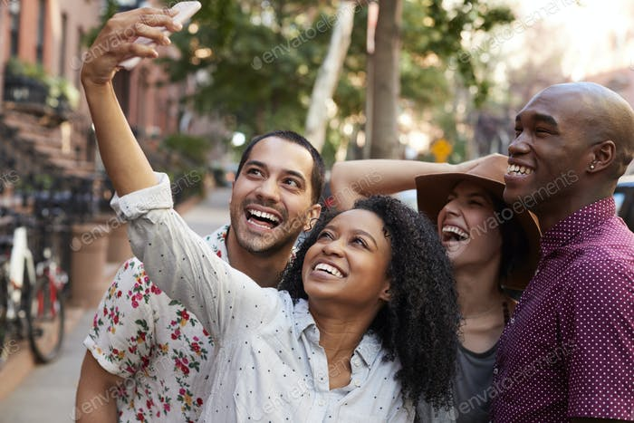 Thumbnail for Group Of Friends Posing For Selfie On Street In New York City