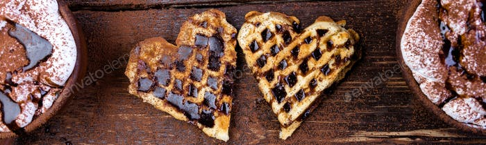 Banner of Belgian heart shaped waffle with hot chocolate with marshmallow.