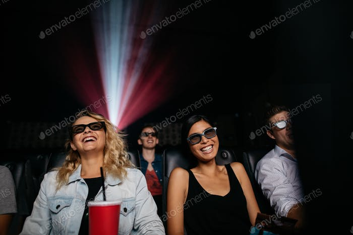 Young women watching 3d movie in theater