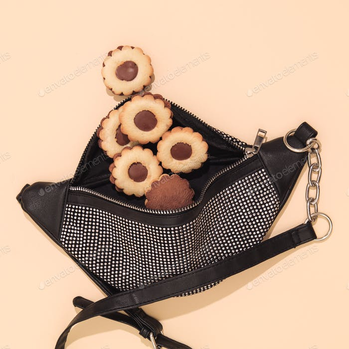Chocolate cookies and clutch bag. Minimal art. diet, calorie, addict, sweet shop concept.