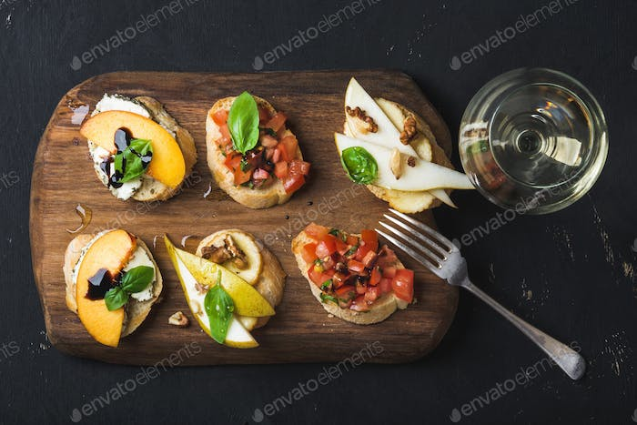 Bruschetta set with glass of white wine