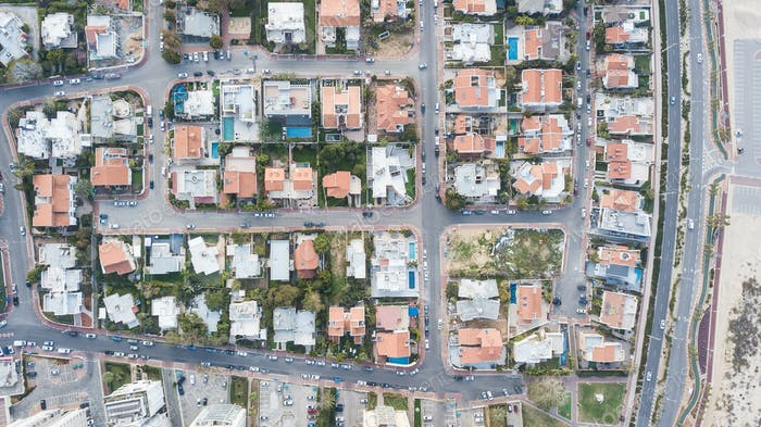 aerial view of private houses district with swimming pools, Israel