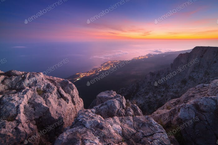 Beautiful landscape on the top of mountains with colorful sky
