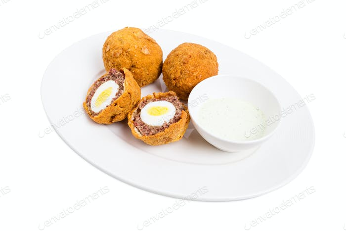 Baked scotch eggs with tartar sauce.