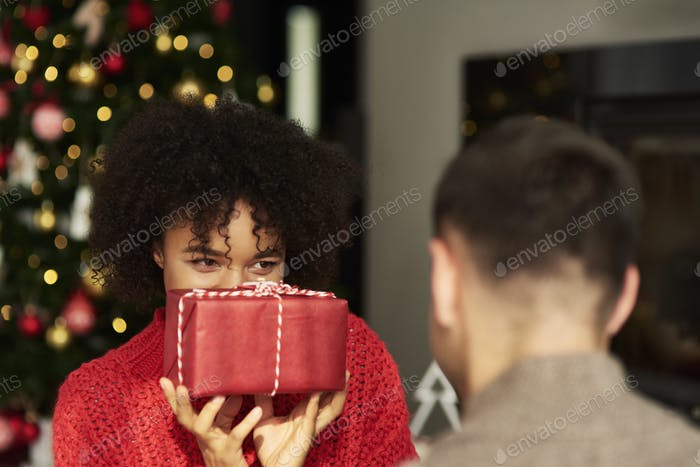 African woman giving the Christmas gift
