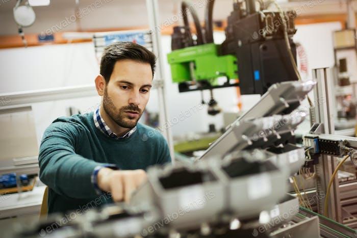 Mechanical engineer working on machines