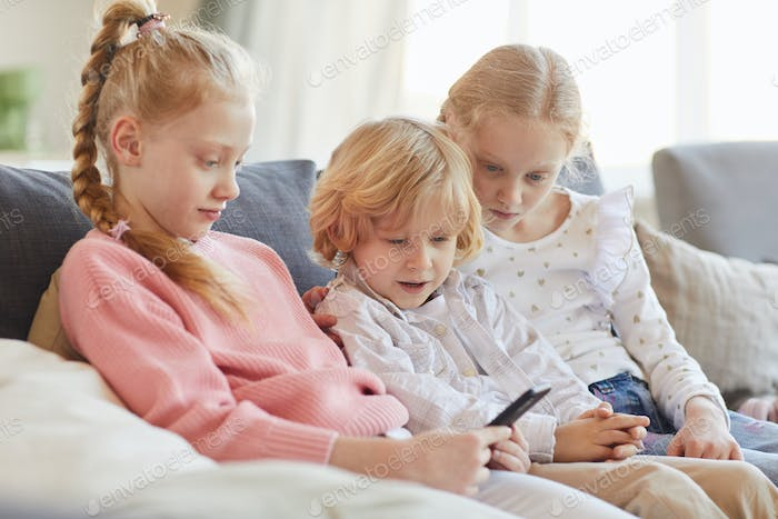 Children using phone at home