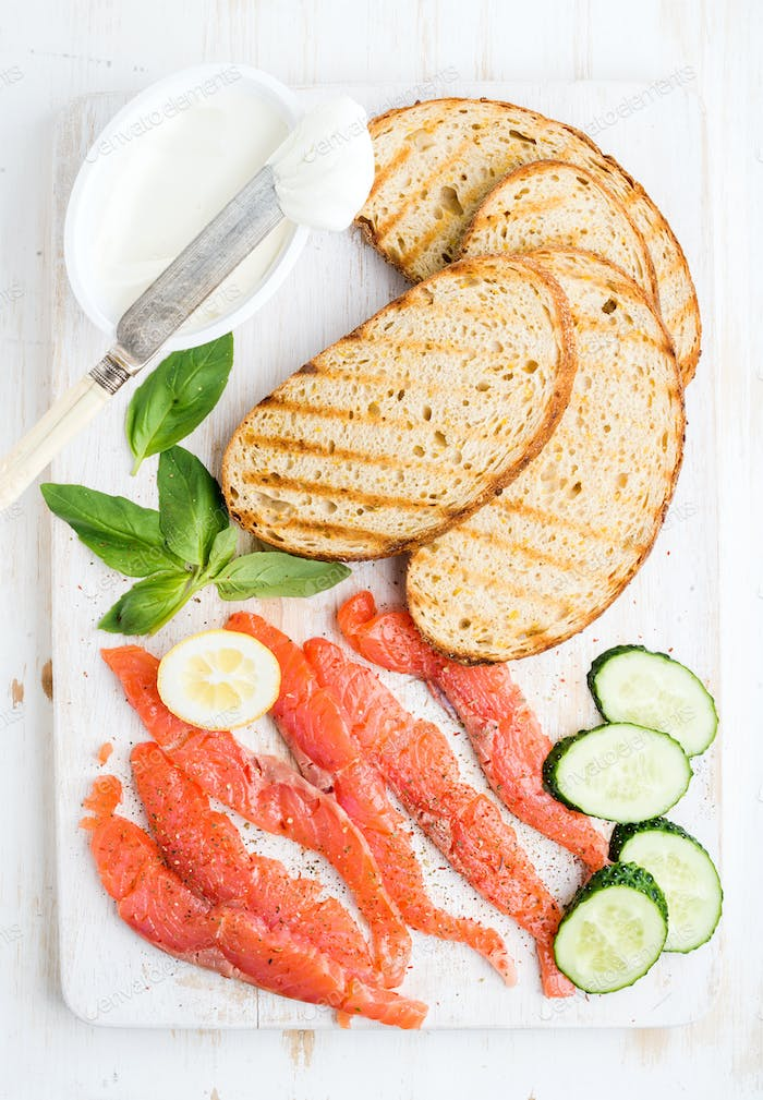 Ingredients for healthy sandwich. Grilled bread slices, smoked salmon, cottage cheese