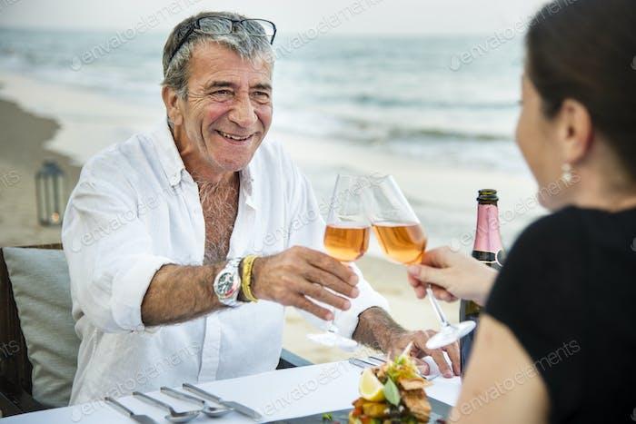 Couple enjoying a romantic dinner at the beach