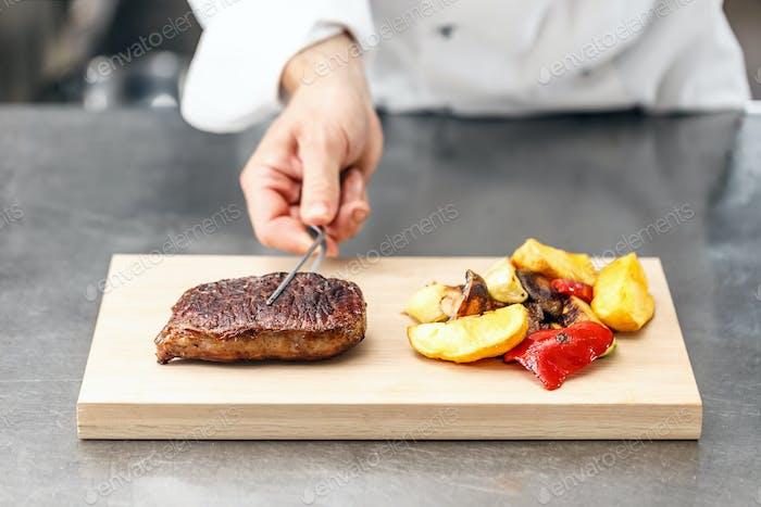Chef served beef steak