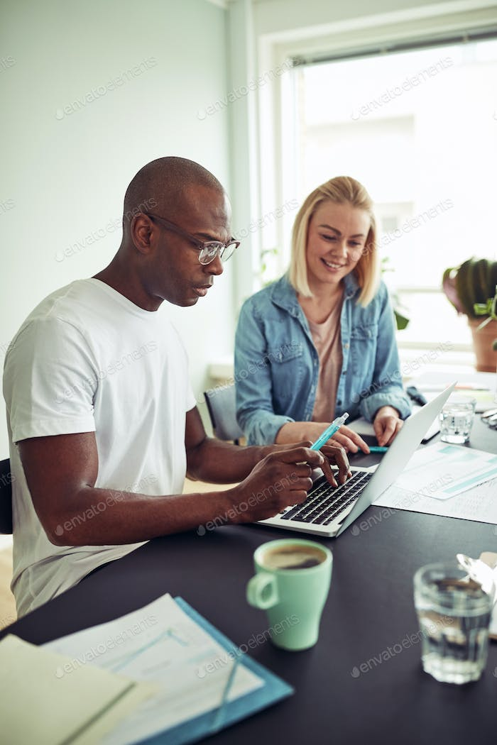 Diverse businesspeople working online with a laptop in an office