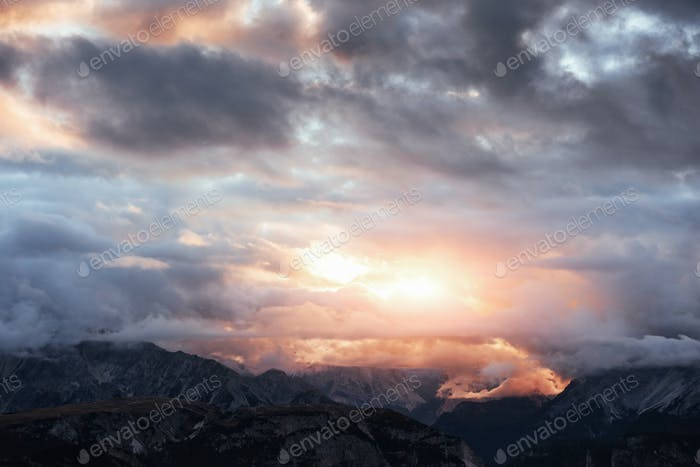 Awesome wide view of the sunset lights illuminate the clouds and creates yellow colored landscape
