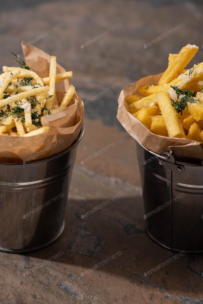 Buckets of Crispy French Fries on Marble Surface