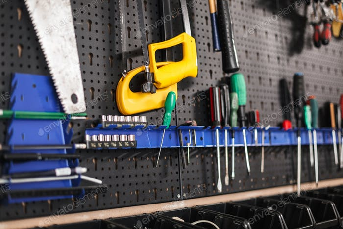 Close up stand of modern tools in workshop isolated