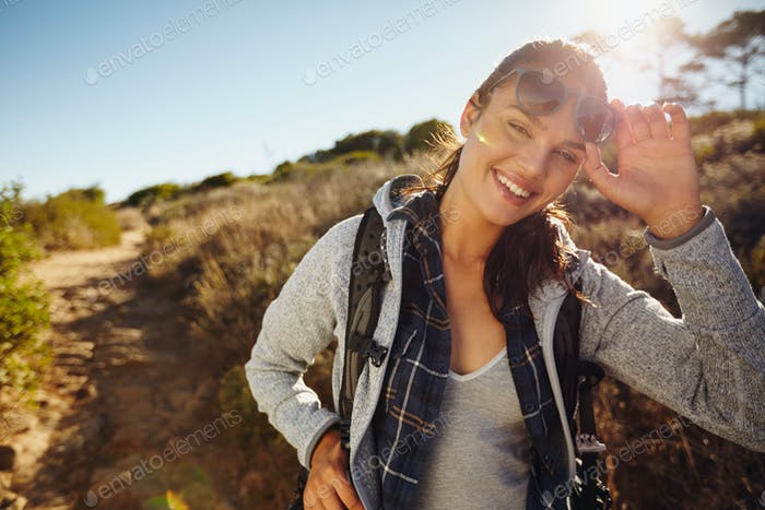 Happy young hiker woman in nature