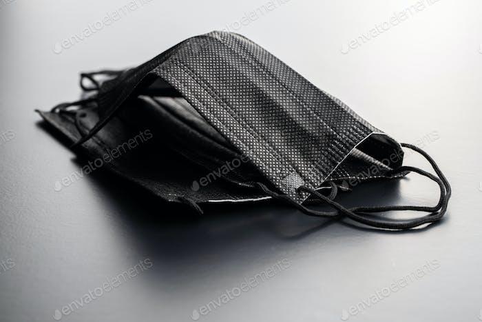 Corona virus protection. Black medical paper face masks