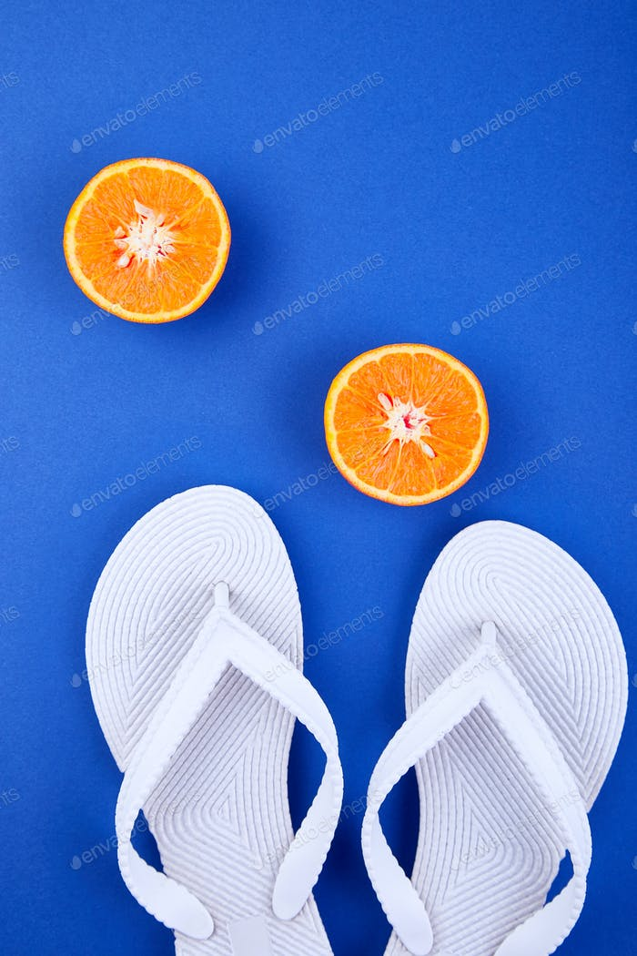 White Flip flops, Orange fruit, seashell