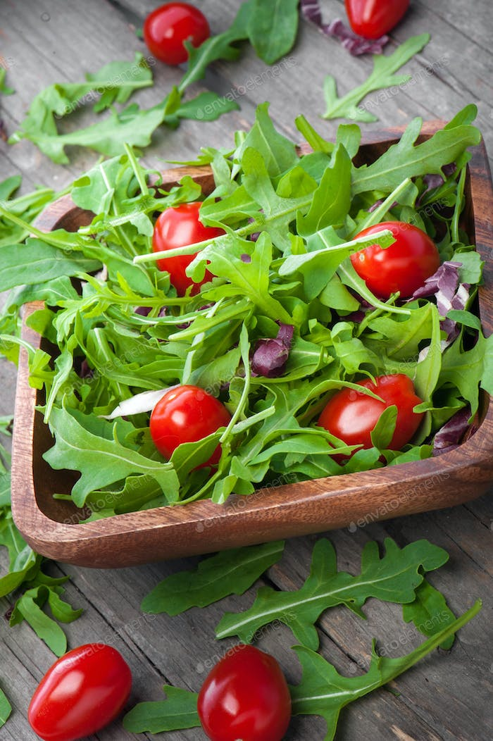 mixed salad in wood with cherry tomatoes
