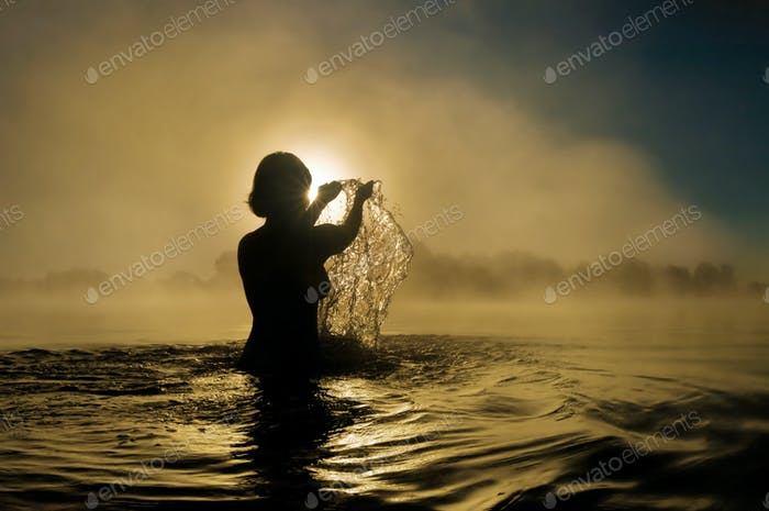 Woman splashing in water
