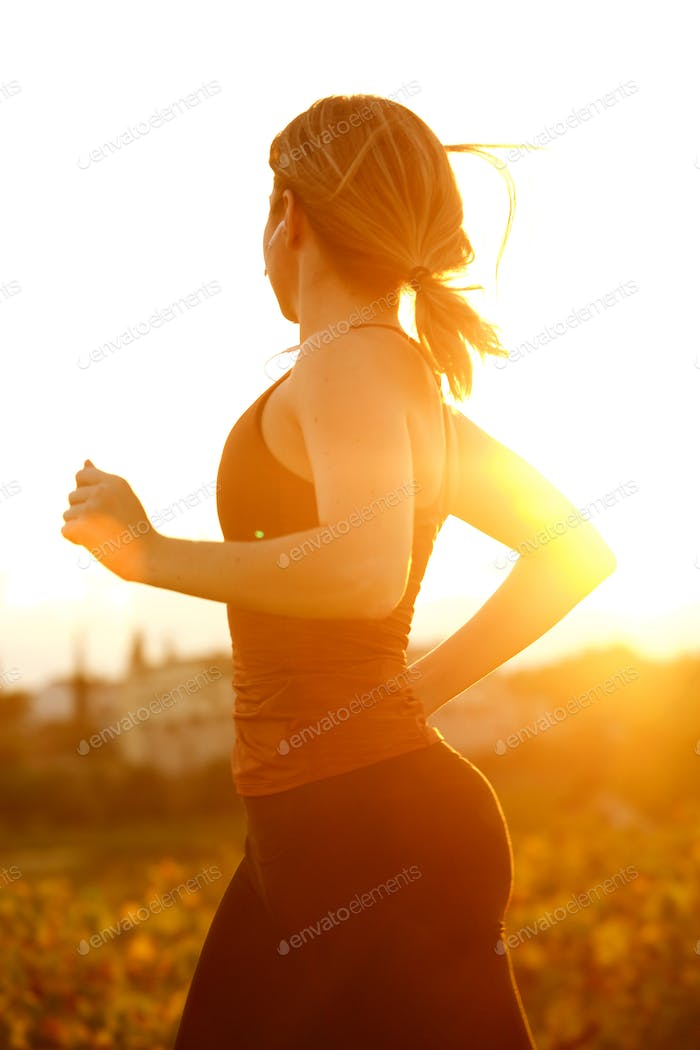 female runner at sunset