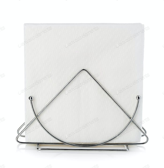 Table napkin holder with napkin close-up isolated on a white background.