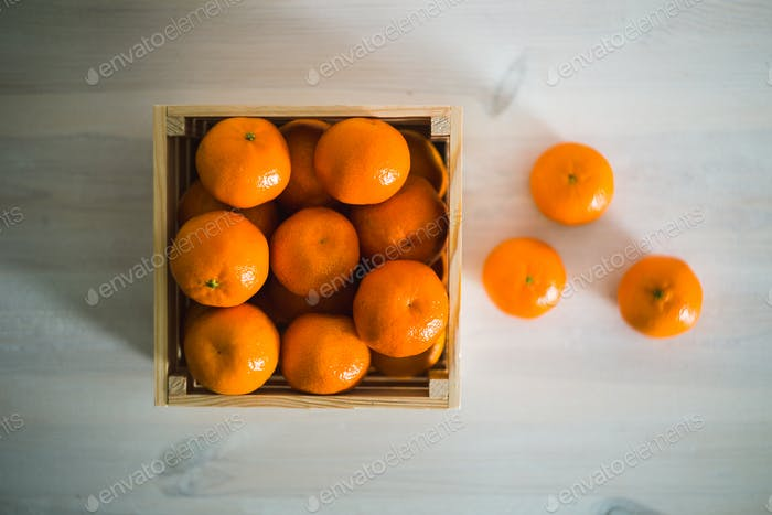 wooden box of fresh mandarin fruits