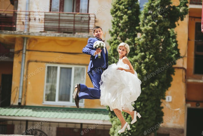 couple jumping on the street