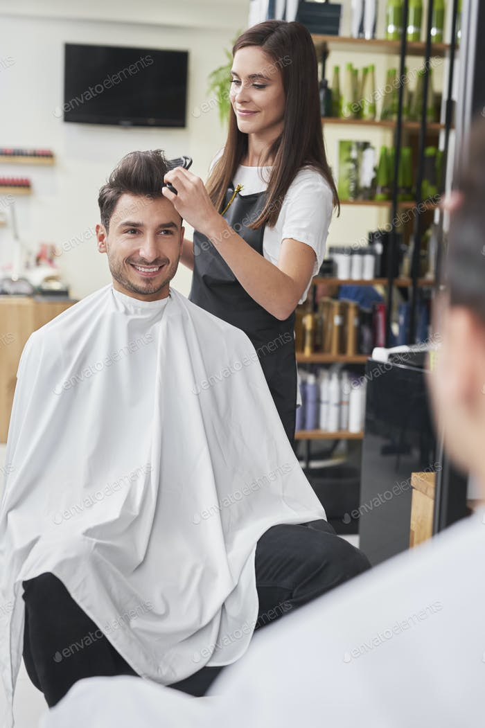 Female hairdresser using comb at work