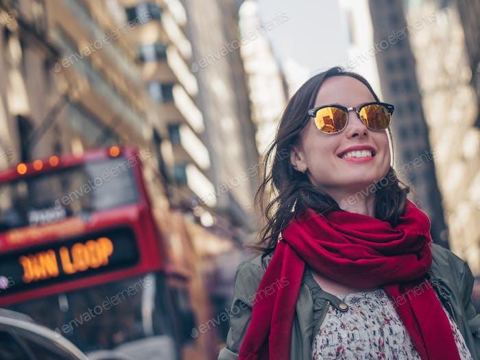 Smiling girl in sunglasses in New York