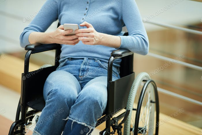 Disabled woman with mobile phone