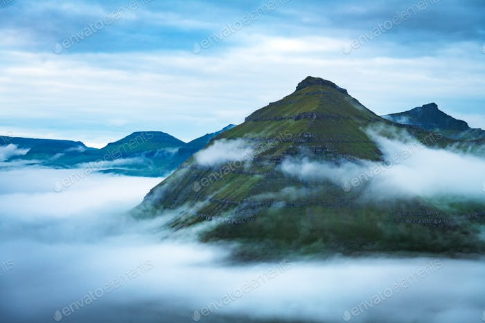 Majestic foggy views over the fjords of Funningur