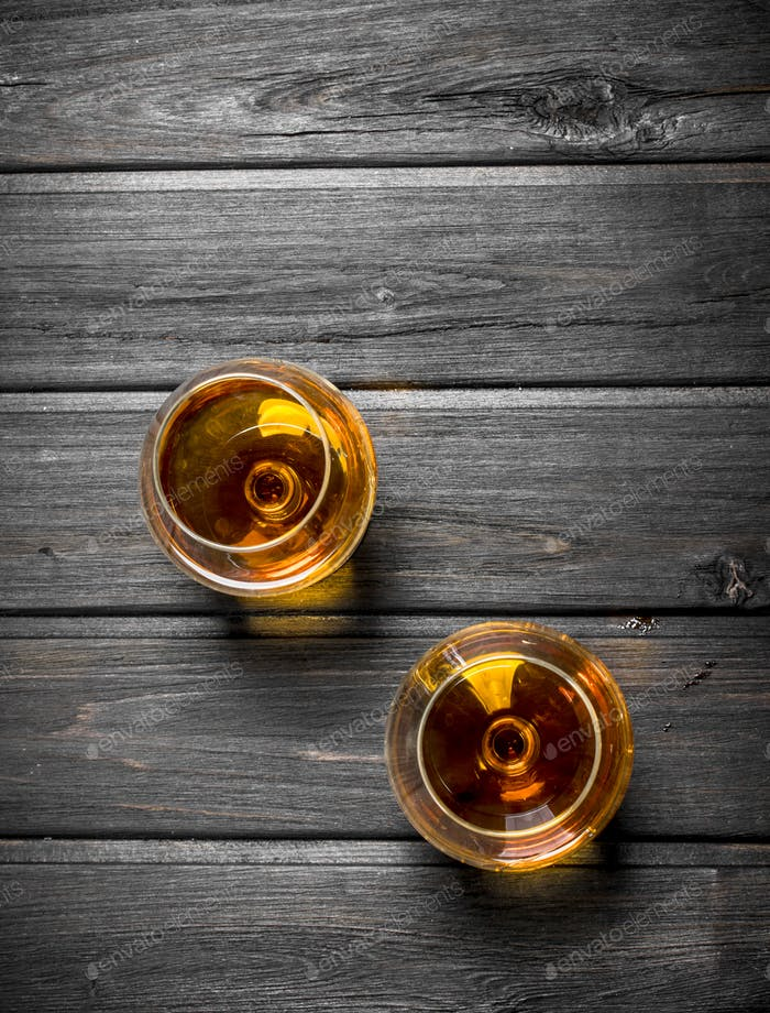 The cognac in the glasses.