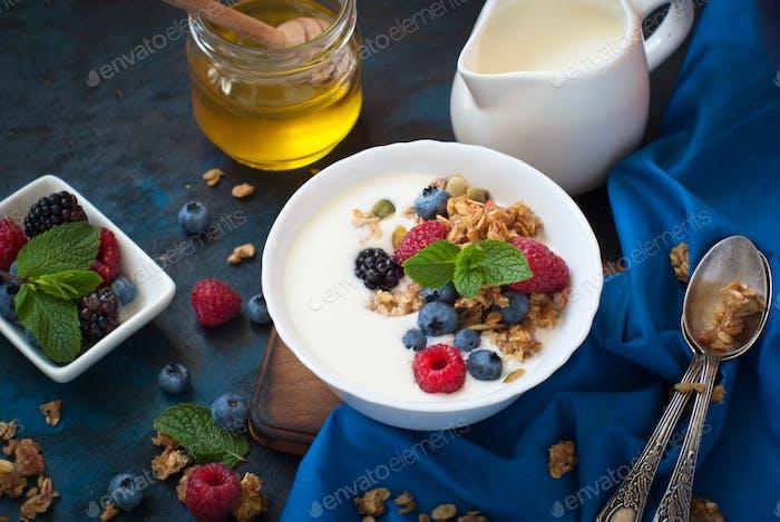Greek yogurt with granola and fresh berries.