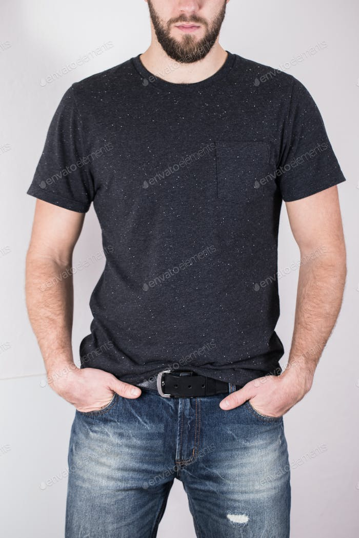blue jeans of a young man wearing grey blank t-shirt