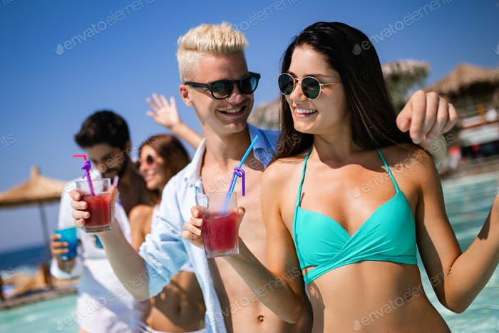 Group of friends having fun on summer vacation. Lifestyle, friendship, travel and holidays concept