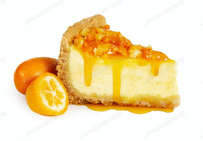 Piece of cheesecake with fresh kumquat and syrup
