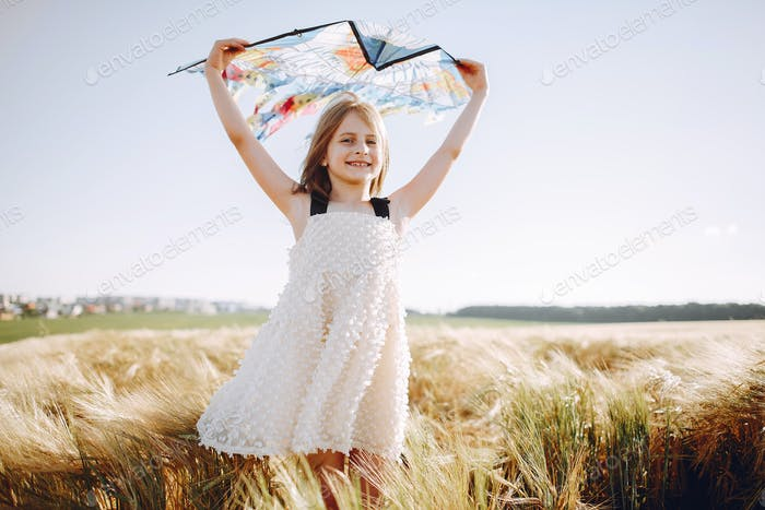 Cute child spend time on a summer field
