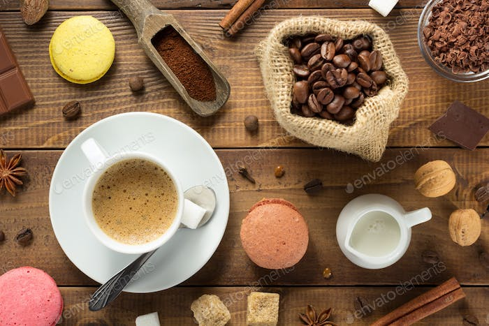 cup of coffee and ingredients with beans
