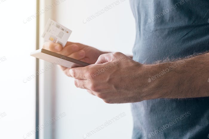 Man registering new GMS sim card on mobile phone