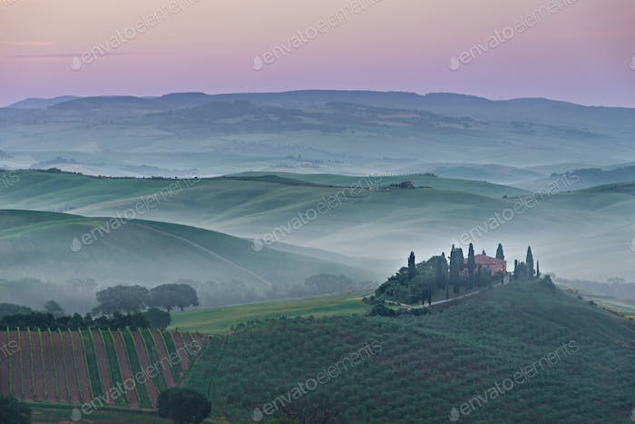 Pink sunrise in a landscape in Tuscany