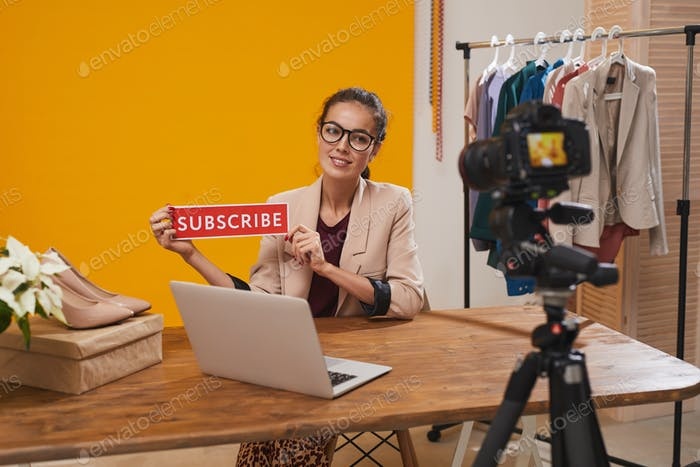 Fashio Blogger Holding Subscribe Button