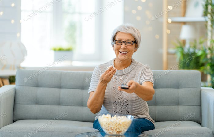 Senior woman watching TV