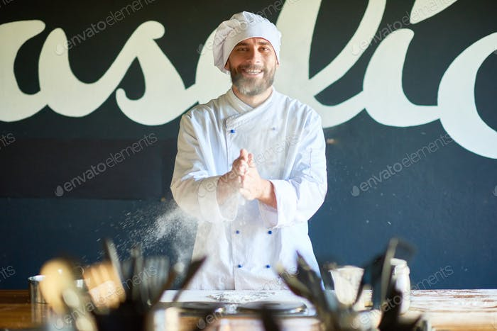 Portrait of Cheerful Bearded Chef