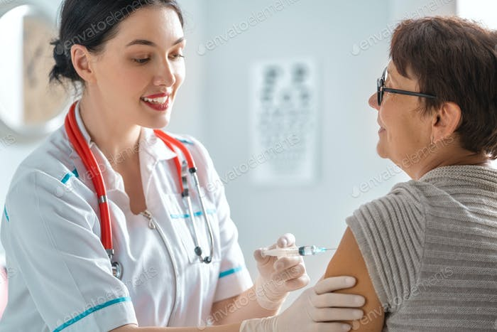 Doctor vaccinating a woman