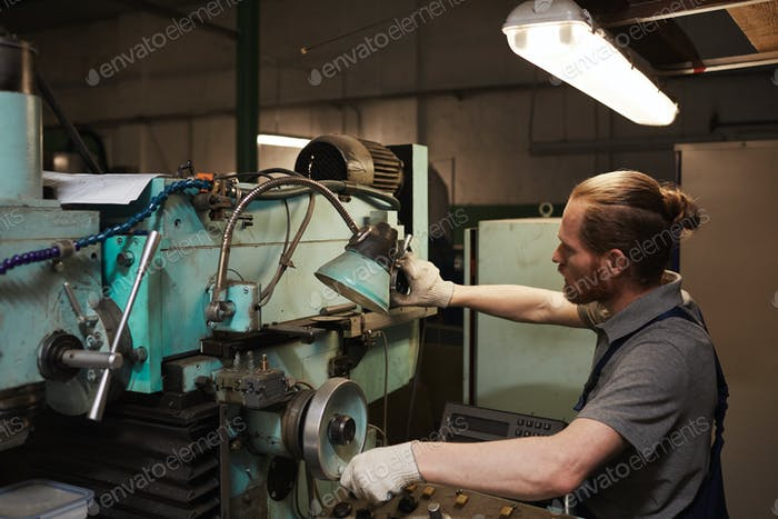 Mechanic working on lathe